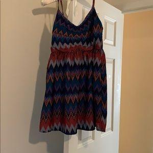 To you dress size medium, zips up the back